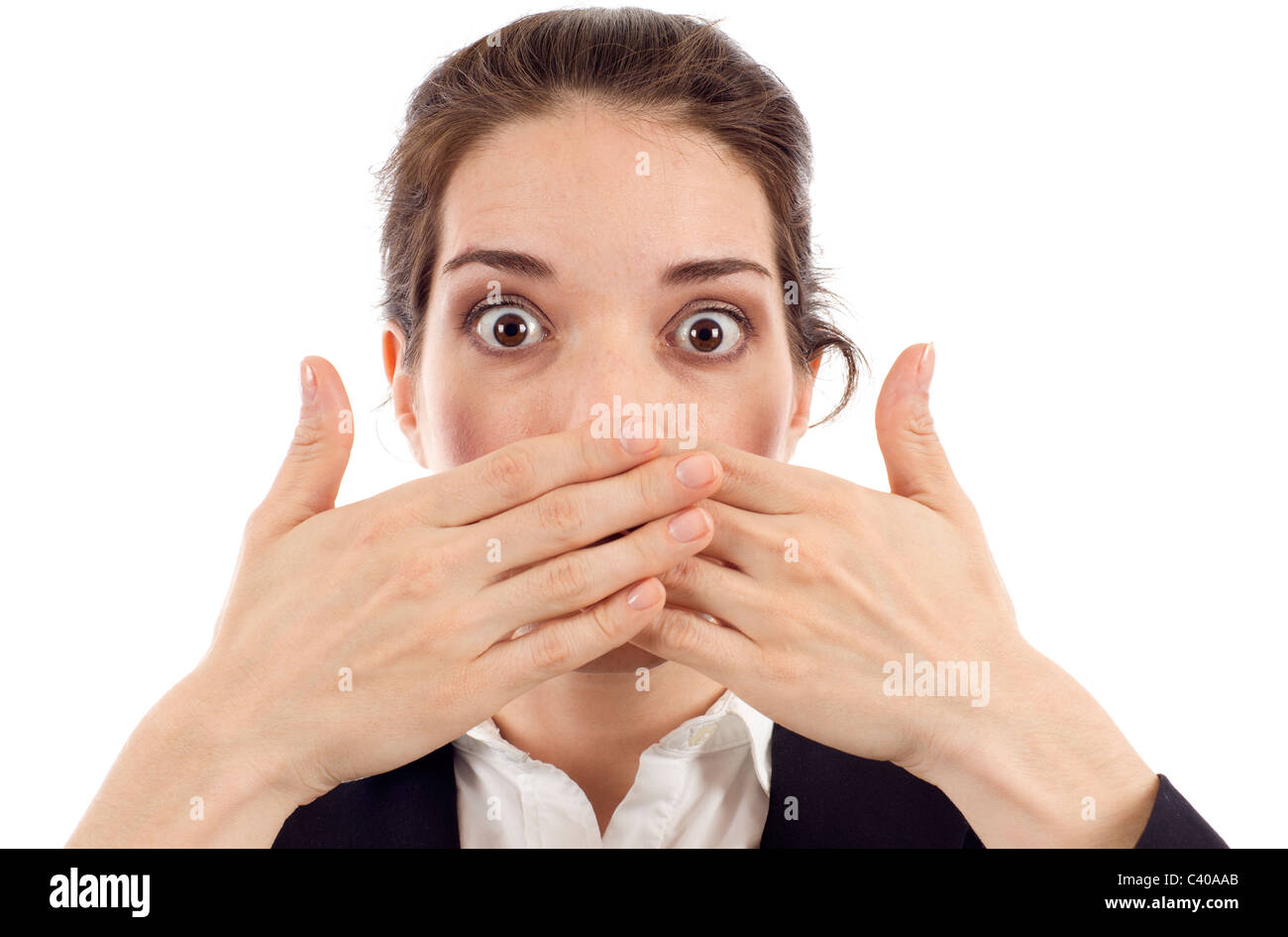 Young woman covering her mouth with both hands isolated over white background - Stock Image