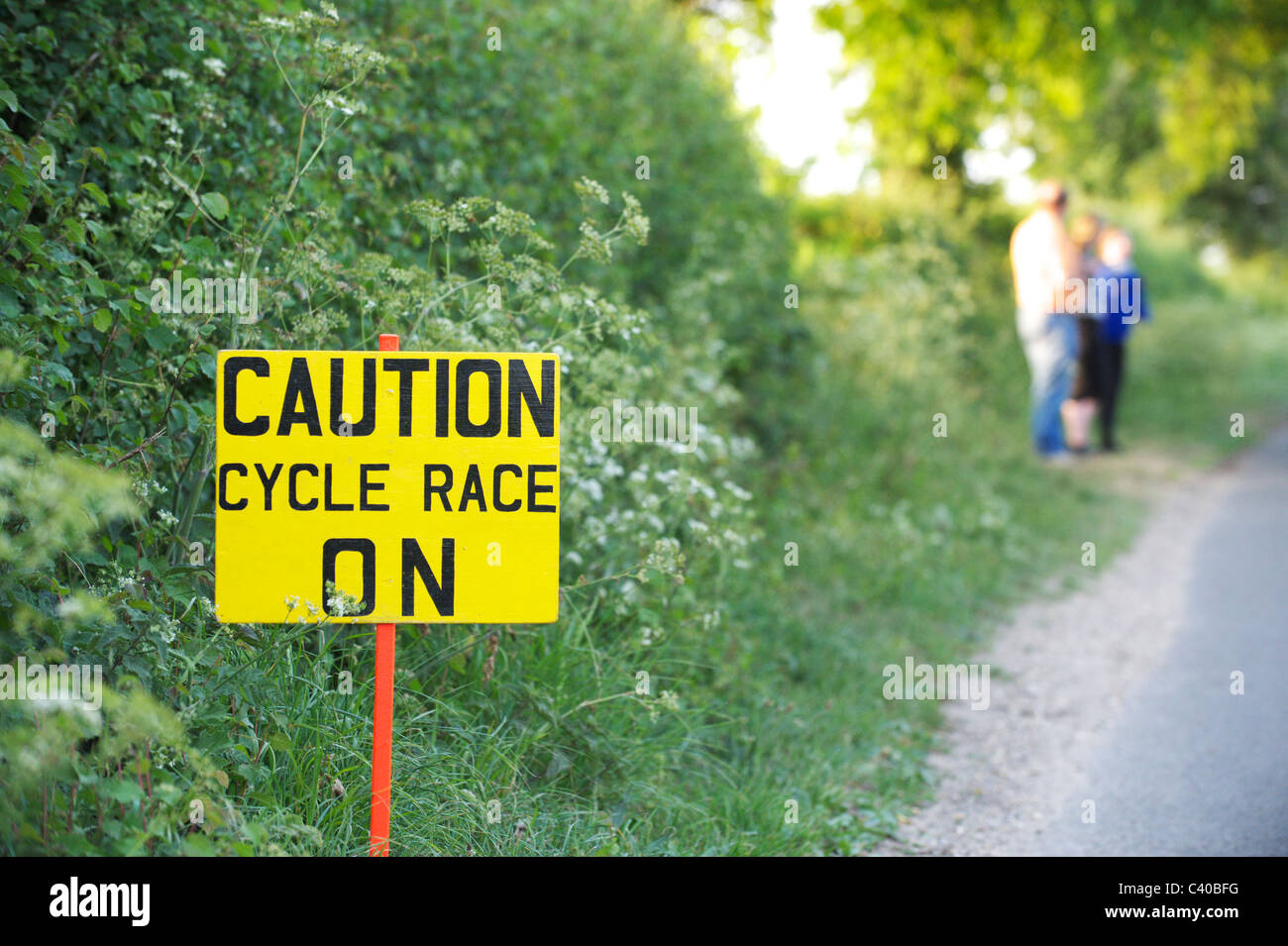 Caution Cycle Race On - sign in British country lane for amateur cycling race - Stock Image