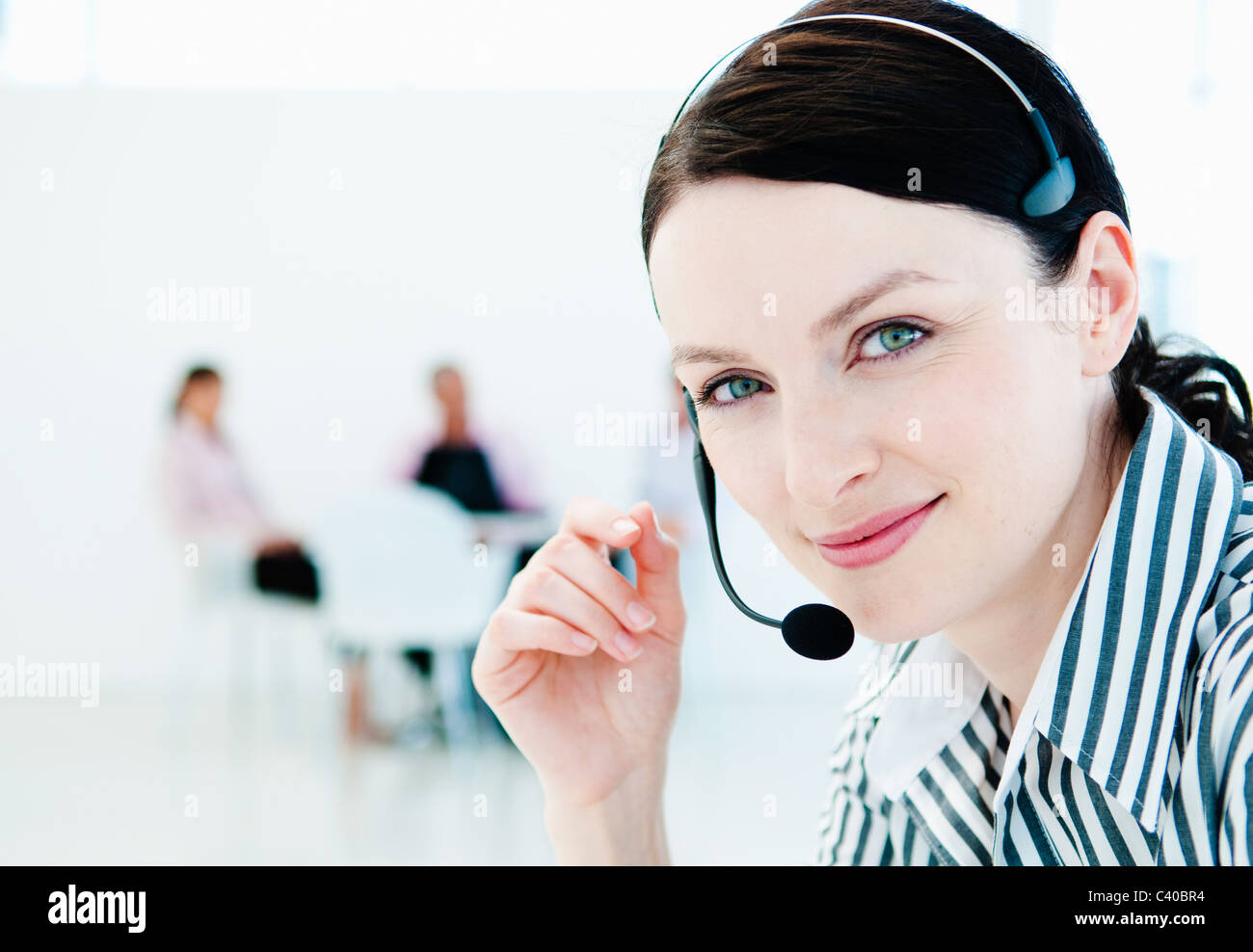 Confident tele sales woman and team - Stock Image