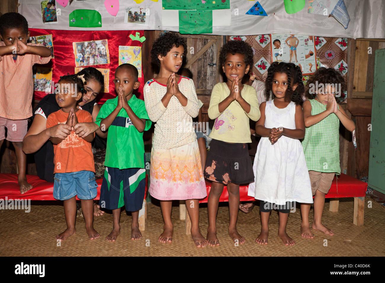 Children singing in Kindergarten, Pacific Harbour, Viti Levu, Fiji - Stock Image