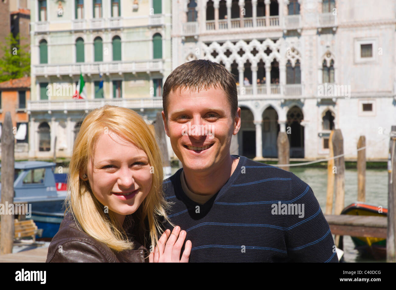 Russian couple by Canal Grande canal Venice Italy Europe - Stock Image