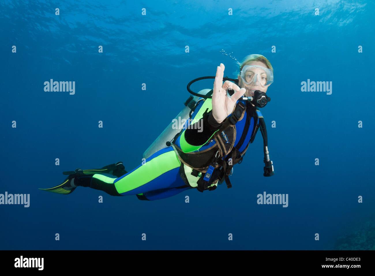Scuba Diver shows O.K. Signal, Wakaya, Lomaiviti, Fiji - Stock Image
