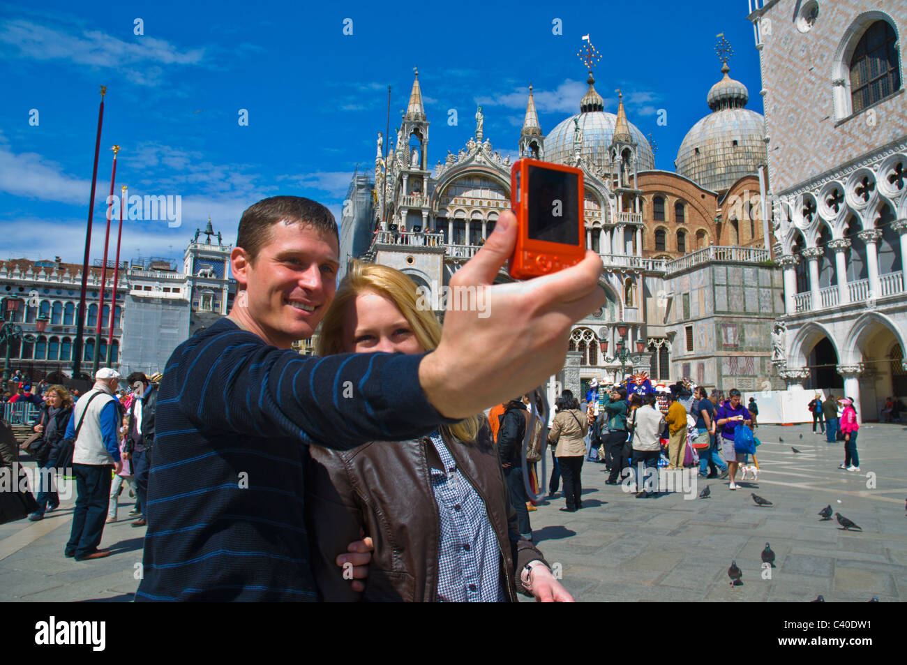 Russian tourists taking photo of themselves at Piazza San Marco square Venice Italy Europe - Stock Image