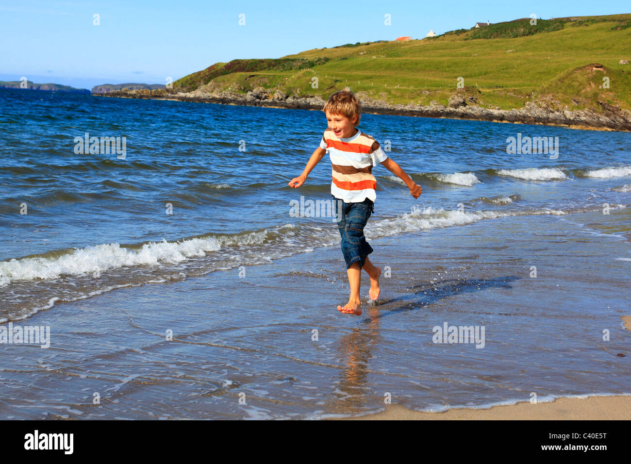 7, 7-year-old, activity, bathing suit, swimming trunks, bay, holidays, boy, child, boy, coast, person, nature, North, - Stock Image