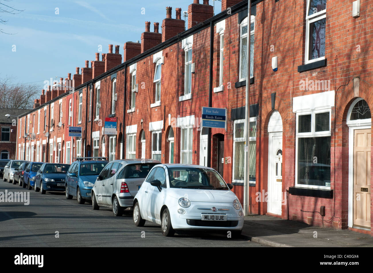 On street parking, row of terraced houses, Edgeley, Stockport. - Stock Image
