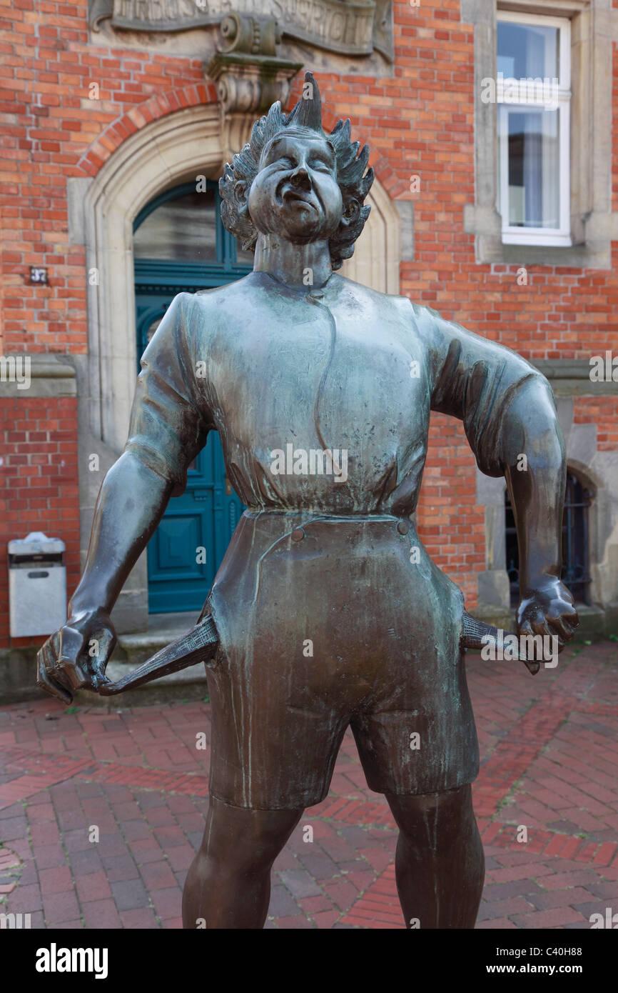 Sculpture, poor tax citizen, Hans-Gerd Ruwe, tax office, Quakenbrueck, Artland, Oldenburger Munsterland, Lower Saxony, - Stock Image