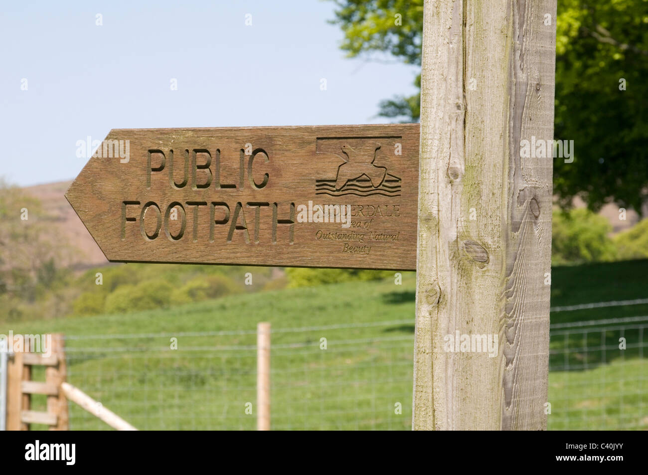 public footpath foot path paths footpaths sign signs right of way rights access to countryside country side post - Stock Image