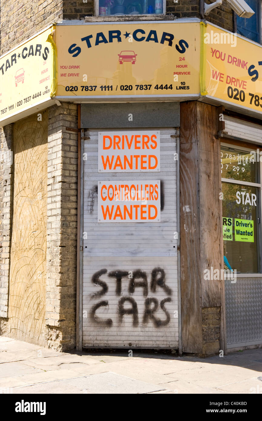 London , Islington , Chapel Market , derelict looking minicab office of Star Cars with drivers & controllers wanted Stock Photo