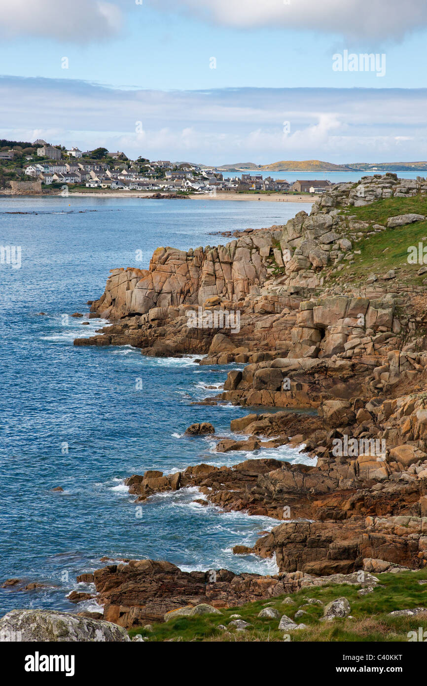 Hugh Town and Porthcressa beach on St Mary's with the island of Bryher beyond on the Isles of Scilly - Stock Image