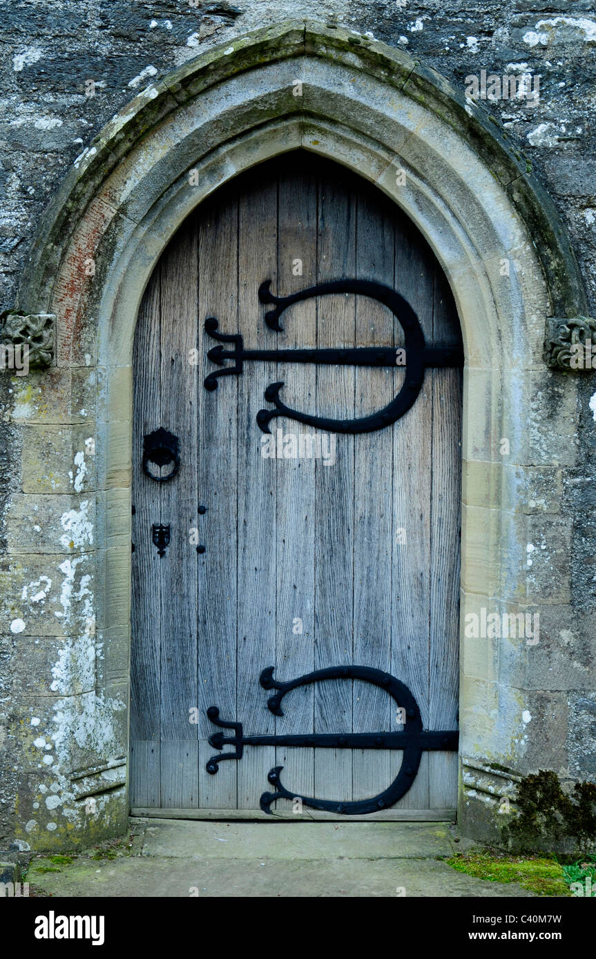 church door entrance ornate iron strap arch house side doorway Stock ...