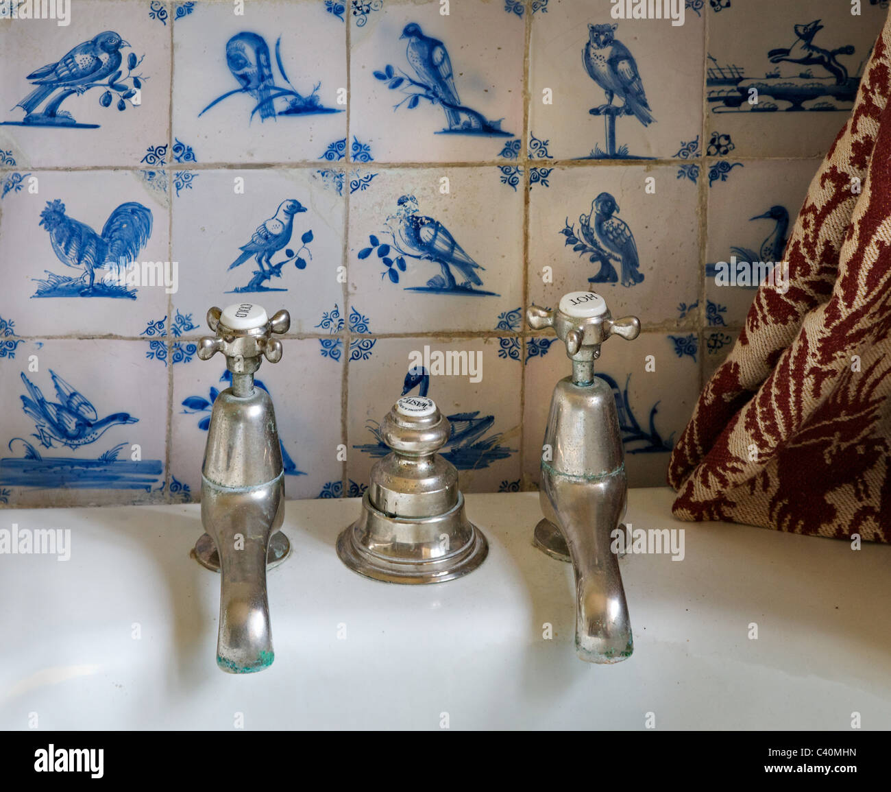 Delft blue stock photos delft blue stock images alamy old bath taps and drain control with hand painted blue delft ceramic tiles with bird motifs dailygadgetfo Image collections