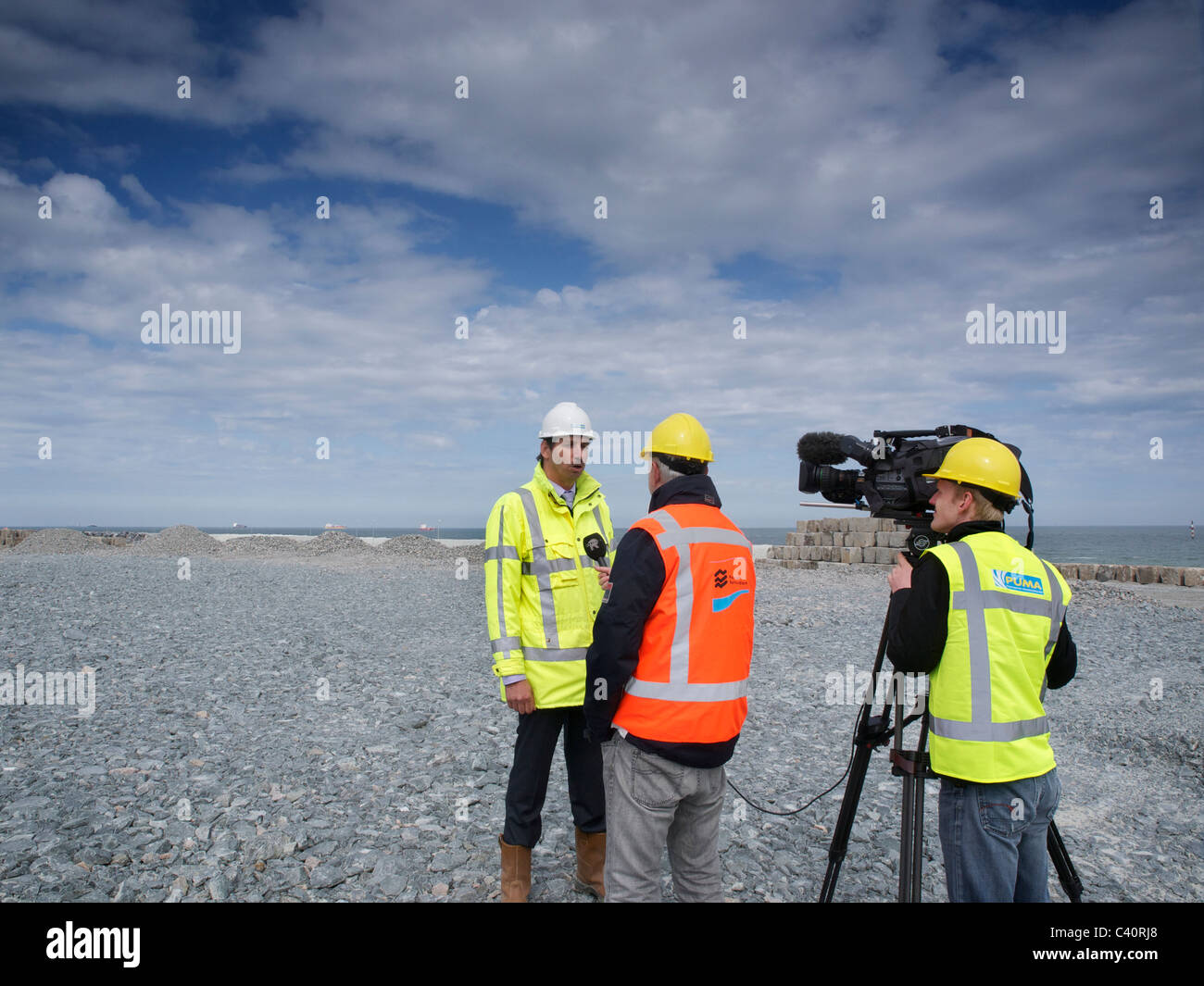 Project manager Jaap Dekker of Puma being interviewed in the stone depot of the Maasvlakte 2 construction site Rotterdam - Stock Image