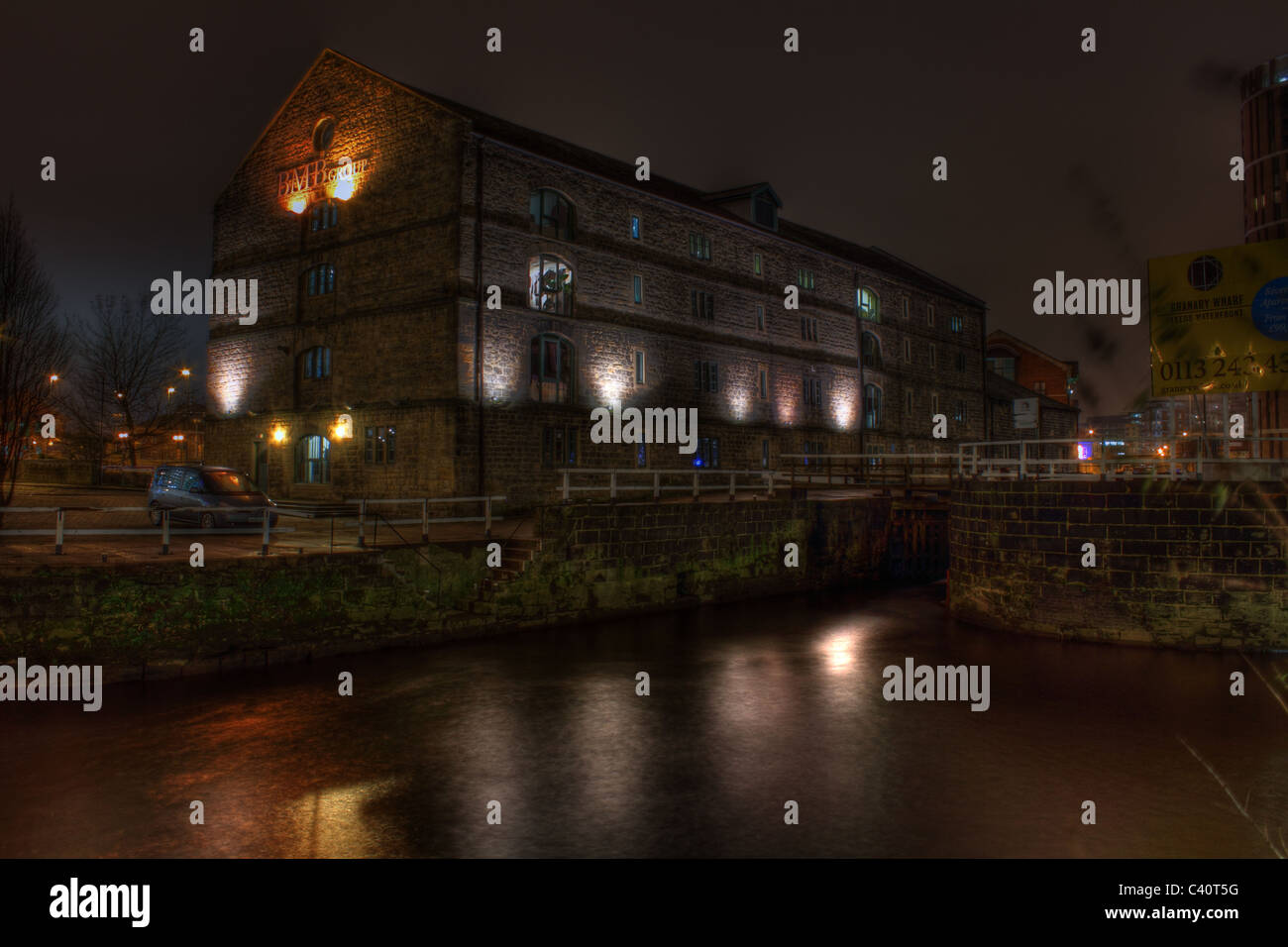 old mill conversion at night - Stock Image