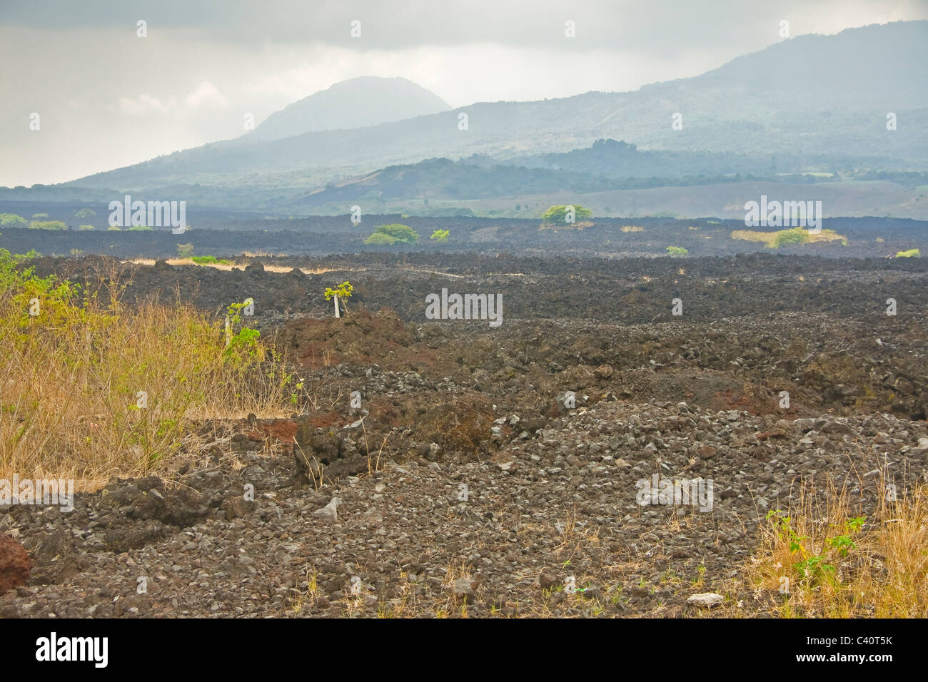 Quetzaltepec volcanic lava field with El Picacho Peak in background near San Salvador - Stock Image