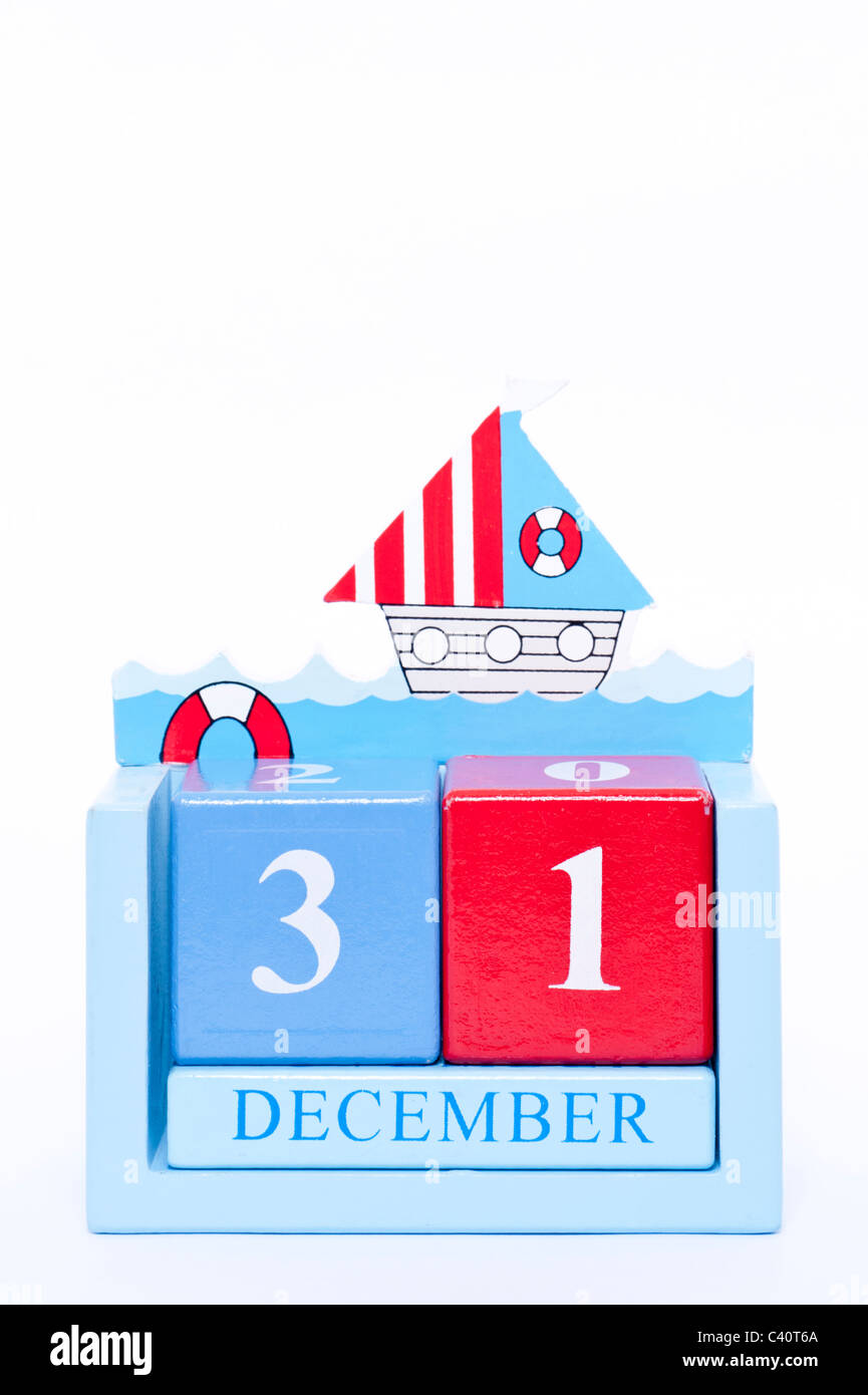 A wooden calendar showing the date of December the 31st ( New Years Eve ) on a white background - Stock Image
