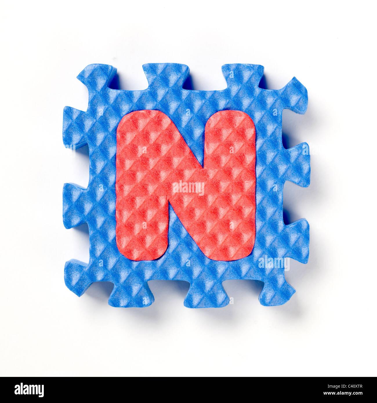 alphabet puzzle piece N - Stock Image