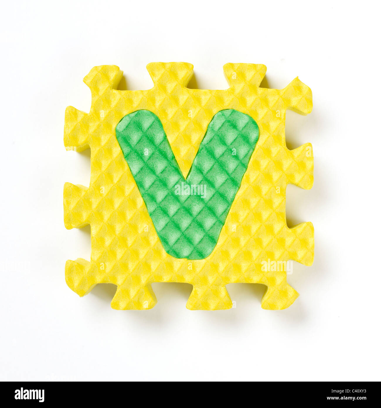 alphabet puzzle piece V - Stock Image