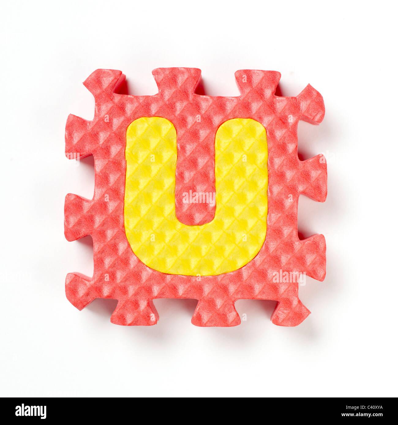 alphabet puzzle piece U - Stock Image