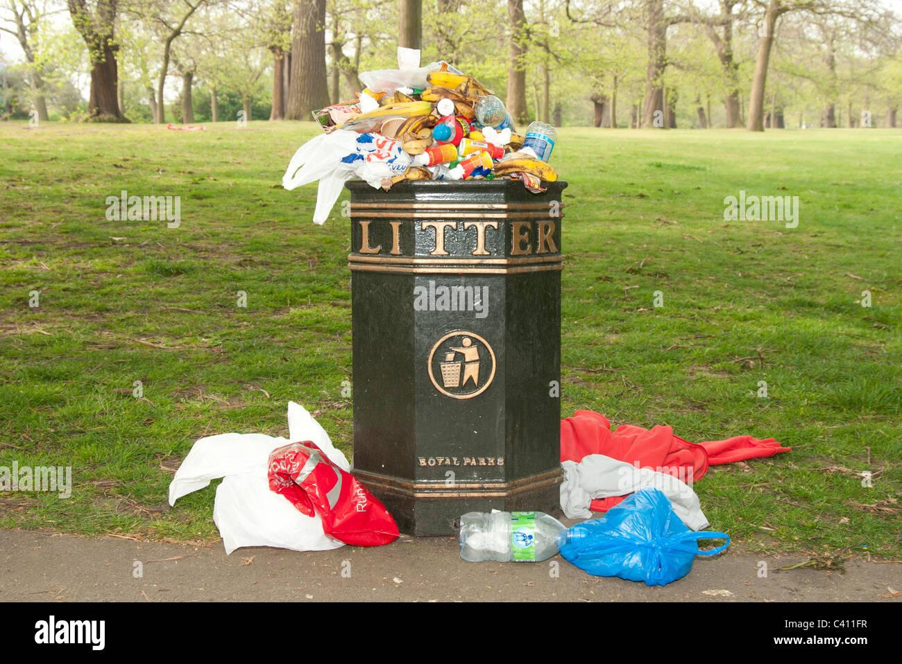overflowing litter bin London UK - Stock Image