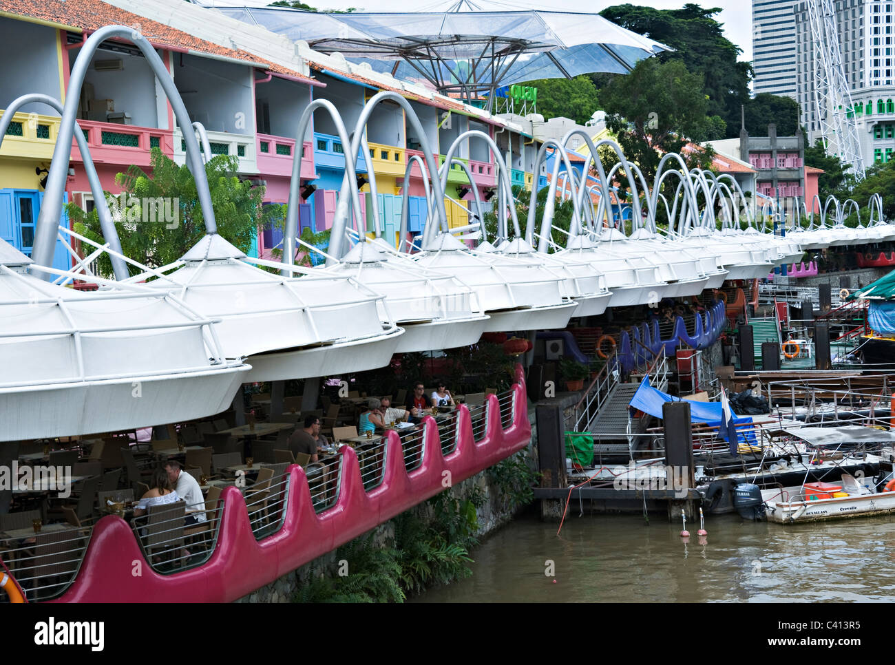 The Colourful Restaurant and Dining Facilities Cafes Bars Bistros with Covered Awnings at Clarke Quay Singapore - Stock Image
