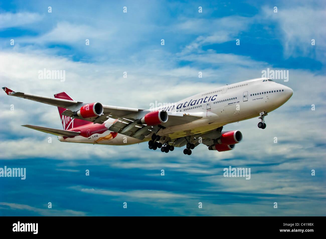 747,virgin,landing,gear,down,flying - Stock Image