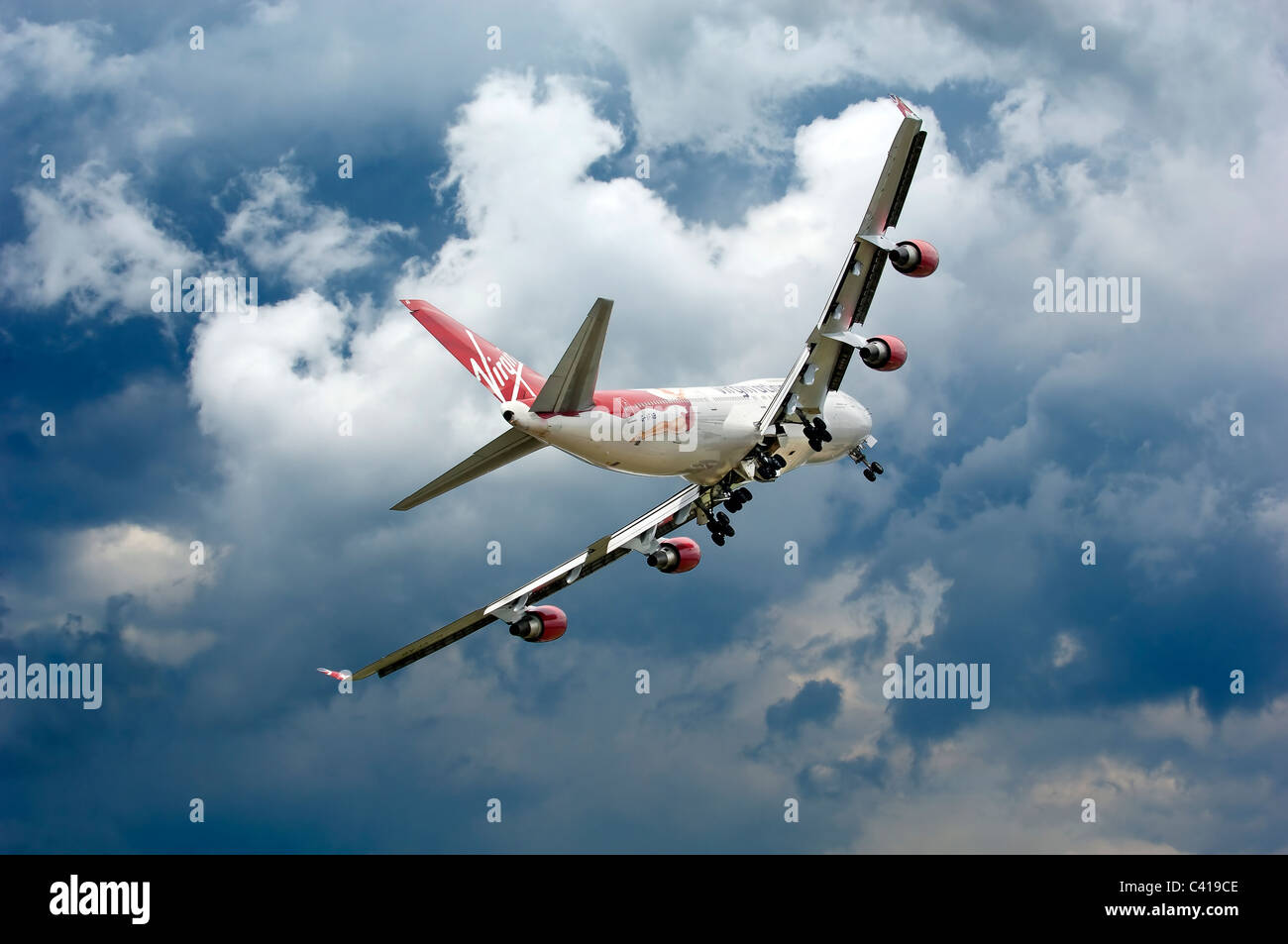 747,virgin,landing,gear,down,flying - Stock Image