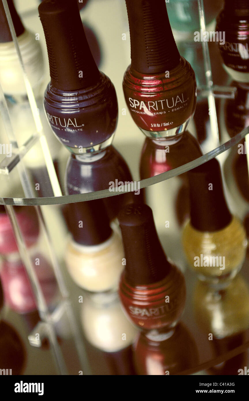 Nail varnish on a perspex stand - Stock Image