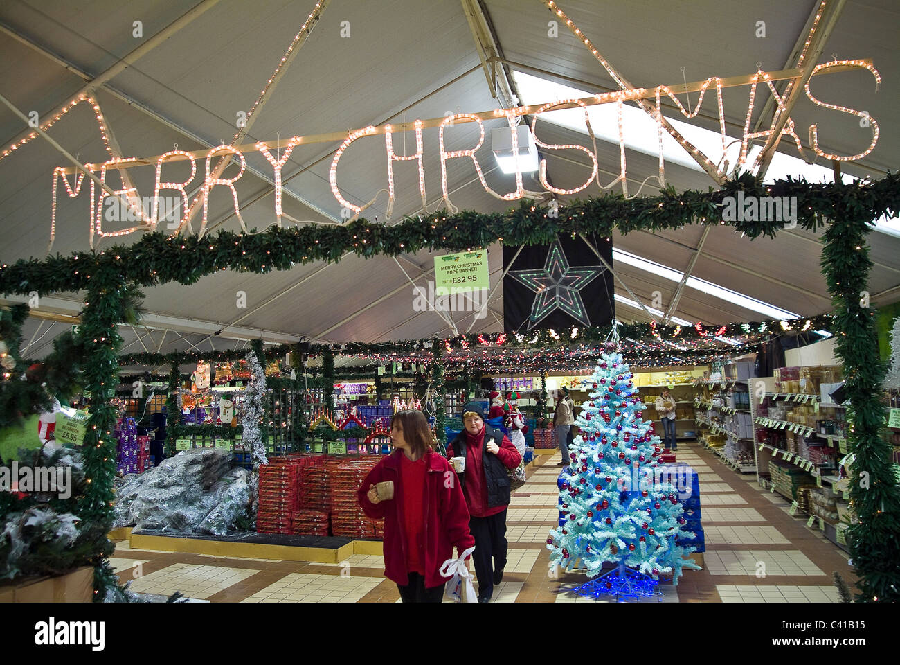 tacky christmas decorations for sale in a gardening centre stock image - Christmas Decorations Sale