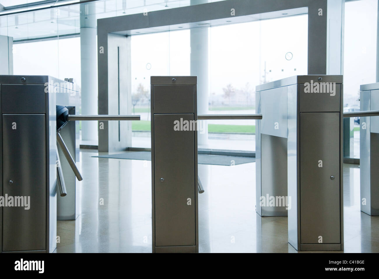 Turnstiles in building lobby - Stock Image