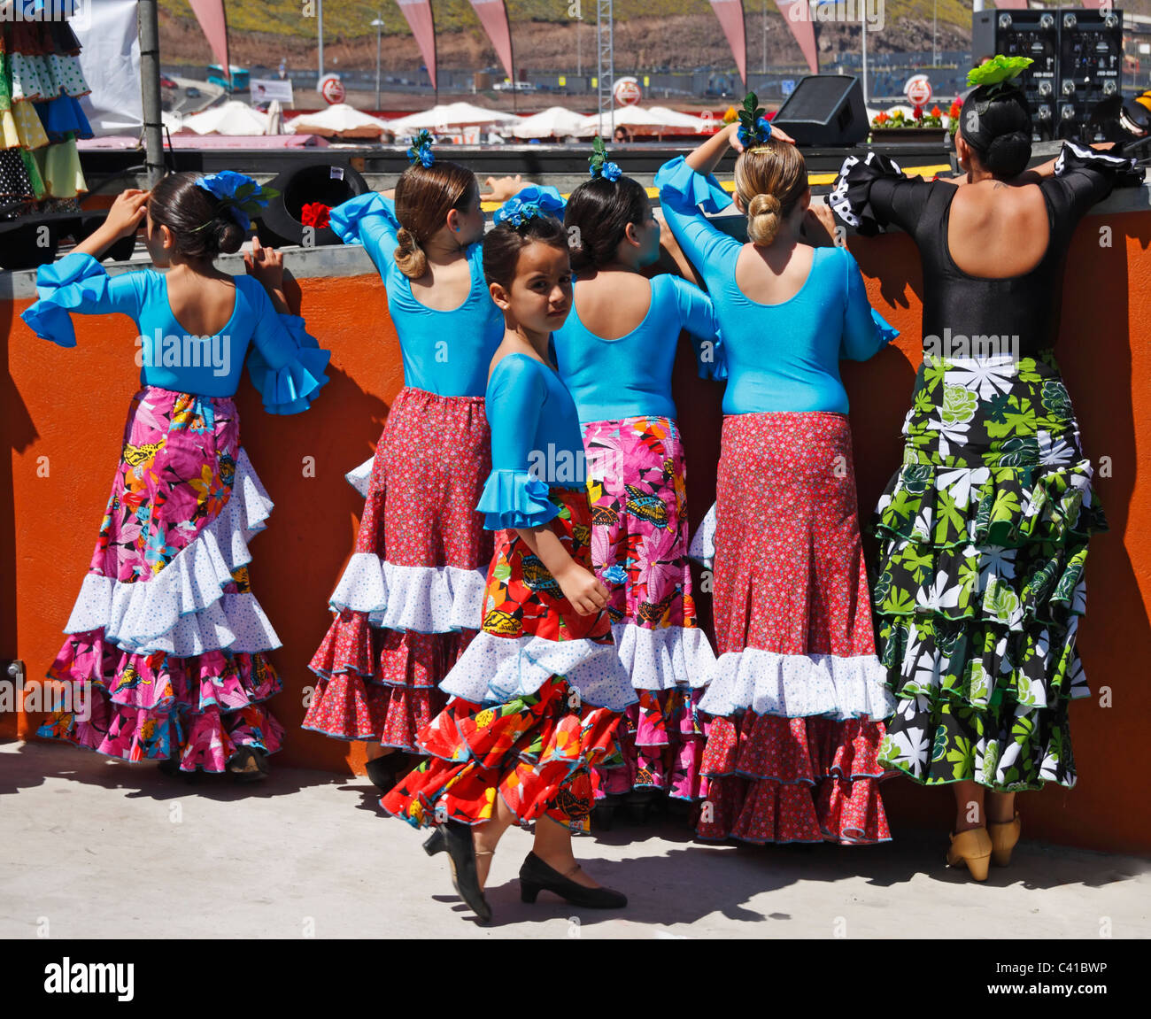 Young Flamenco dancers watching dancer from backstage at Feria de Abril. Spain - Stock Image