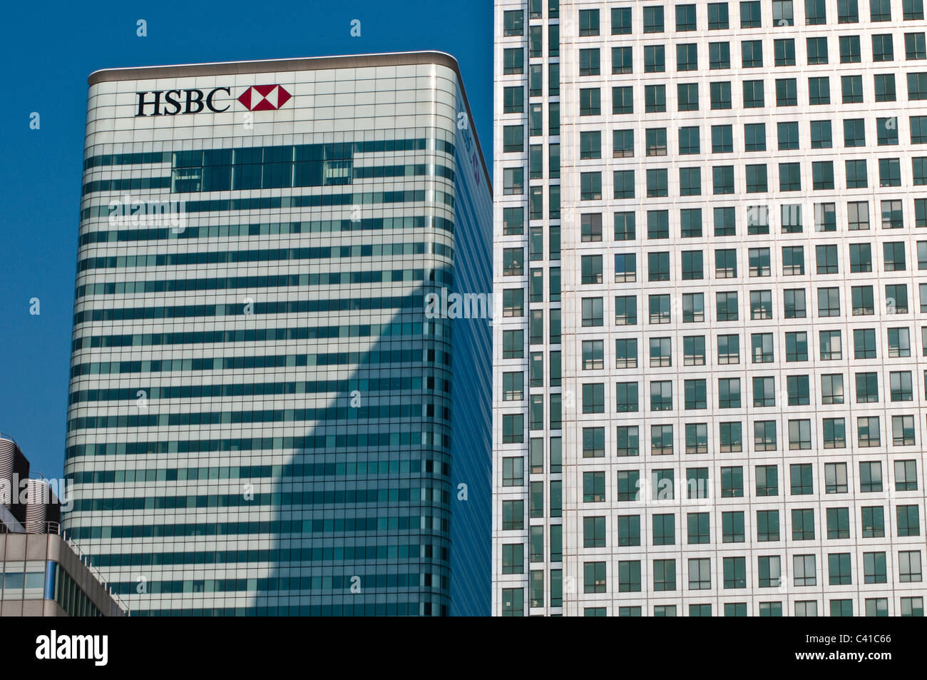Detail of One Canada Square skyscraper and HSBC bank, Canary Wharf, London, UK - Stock Image
