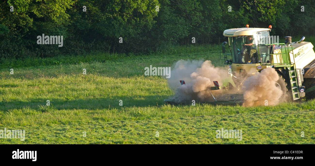 A Krone Big M 500 massive grass cutting machine working in drought conditions in the South of England. - Stock Image