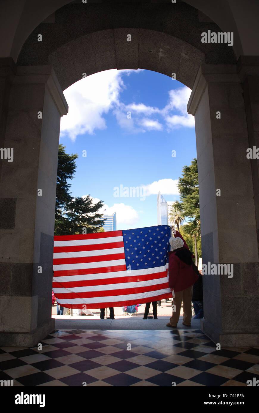 American flag at rally in Sacramento Stock Photo
