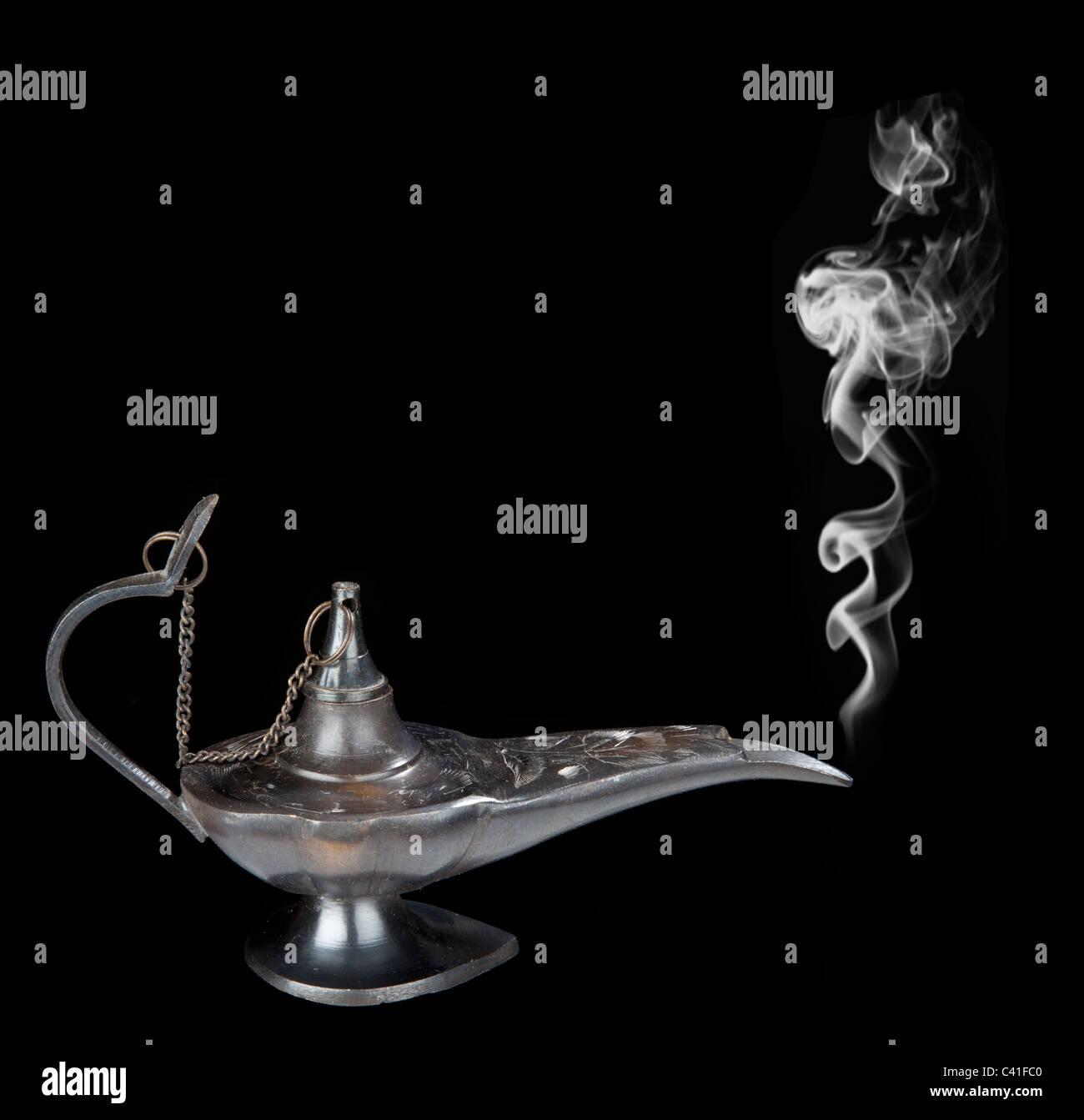 Genie lamp with a smoke - Stock Image