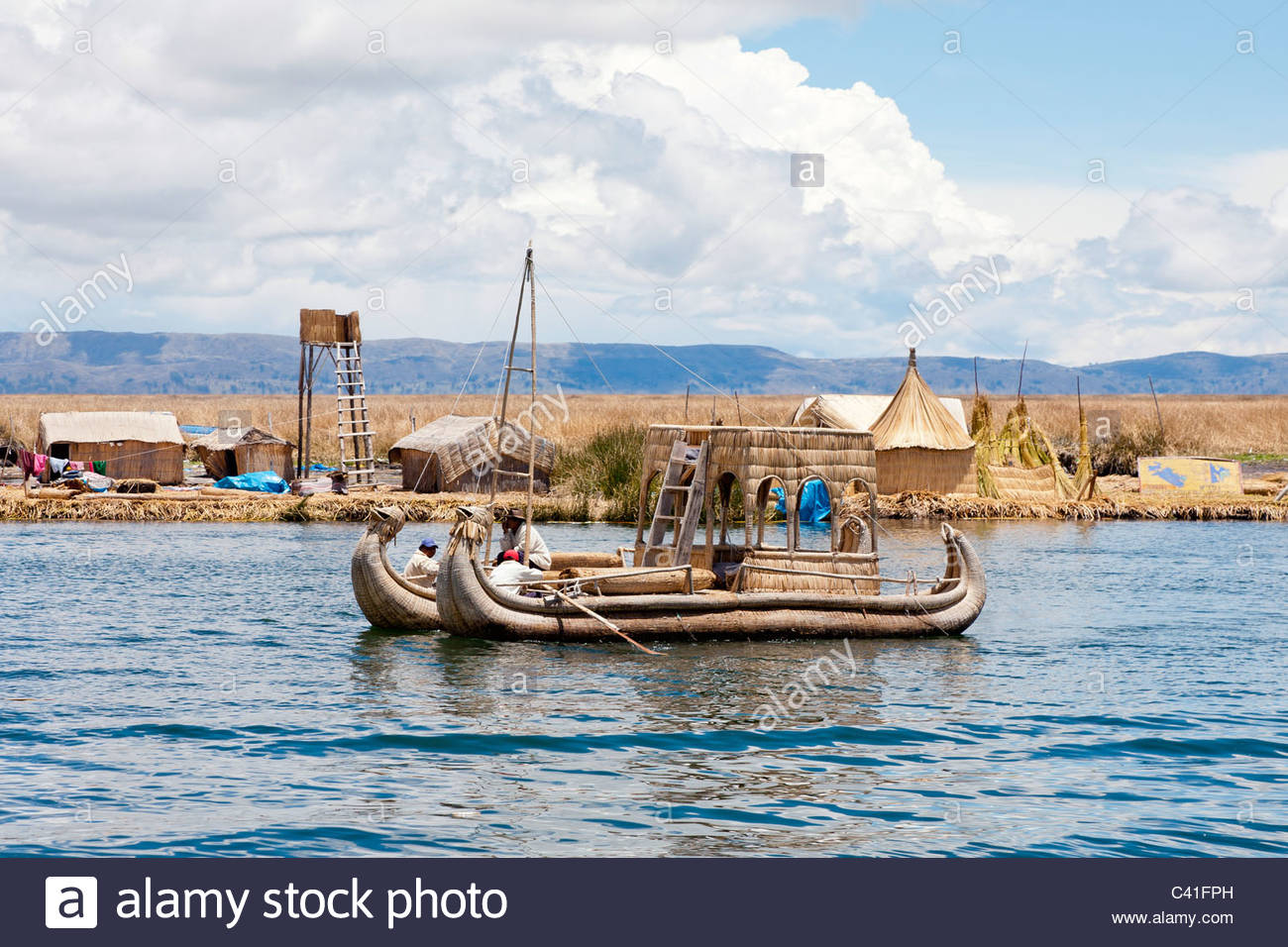 A traditional totora reed boat at the Uros Floating Islands, Lake Titicaca, near Puno, Peru. - Stock Image