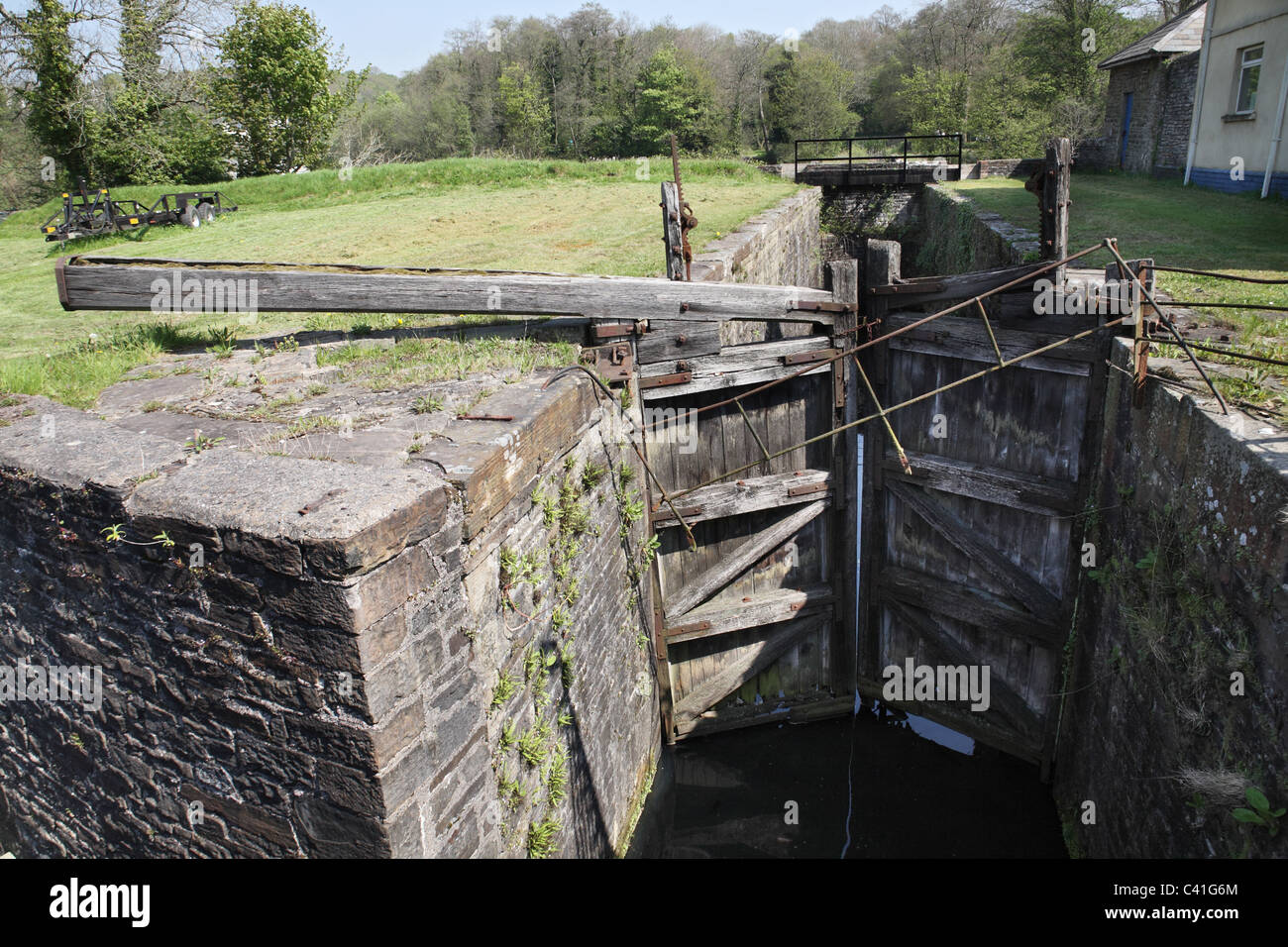 The disused lock gates of the Tennant canal at Aberdulais, Neath, South Wales, UK - Stock Image