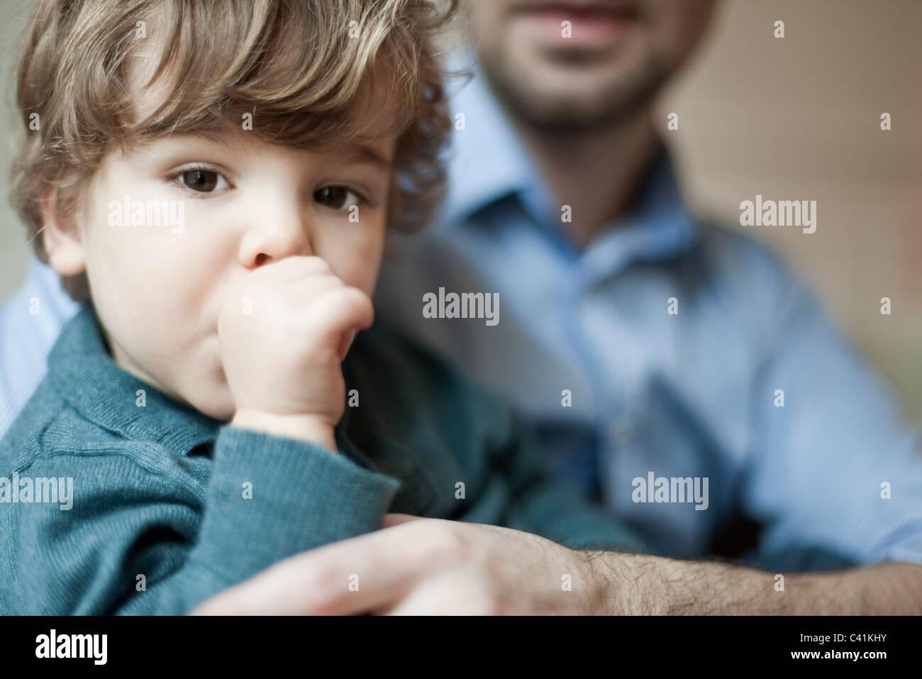 Toddler boy sucking thumb, portrait Stock Photo