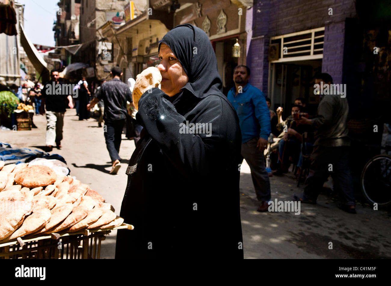 Fresh Pita bread sold on a busy street in Cairo, Egypt. - Stock Image