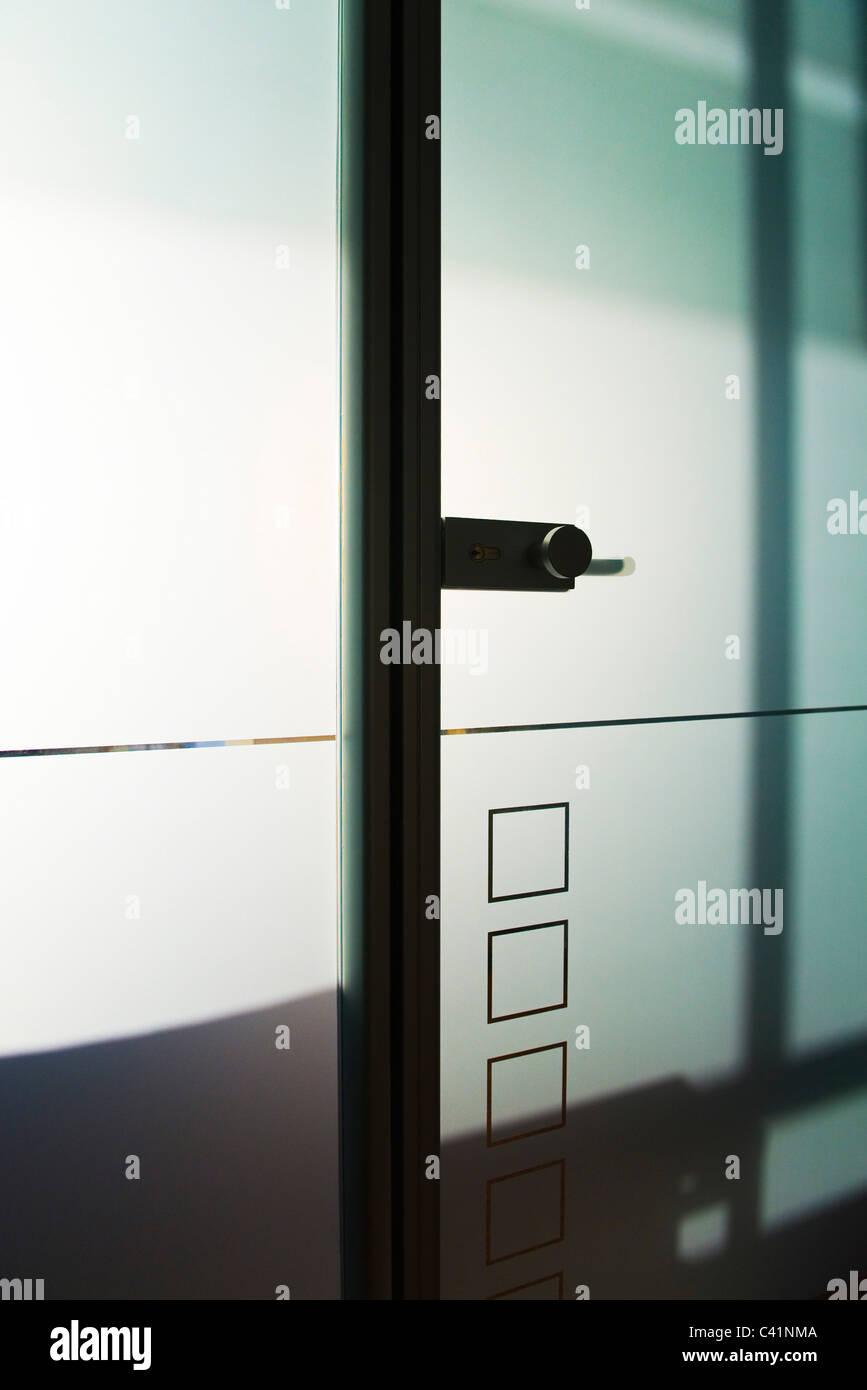Glass door in office - Stock Image