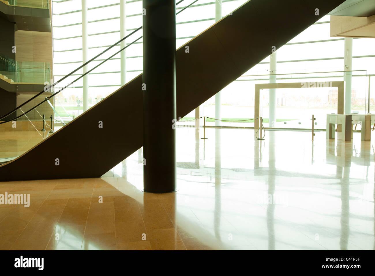 Escalator in lobby - Stock Image