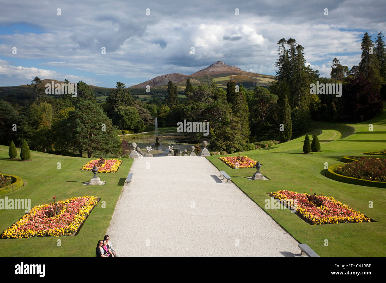 Great Sugarloaf Mountain rises above the gardens of Powerscourt House, Enniskerry, County Wicklow, Ireland. - Stock Image
