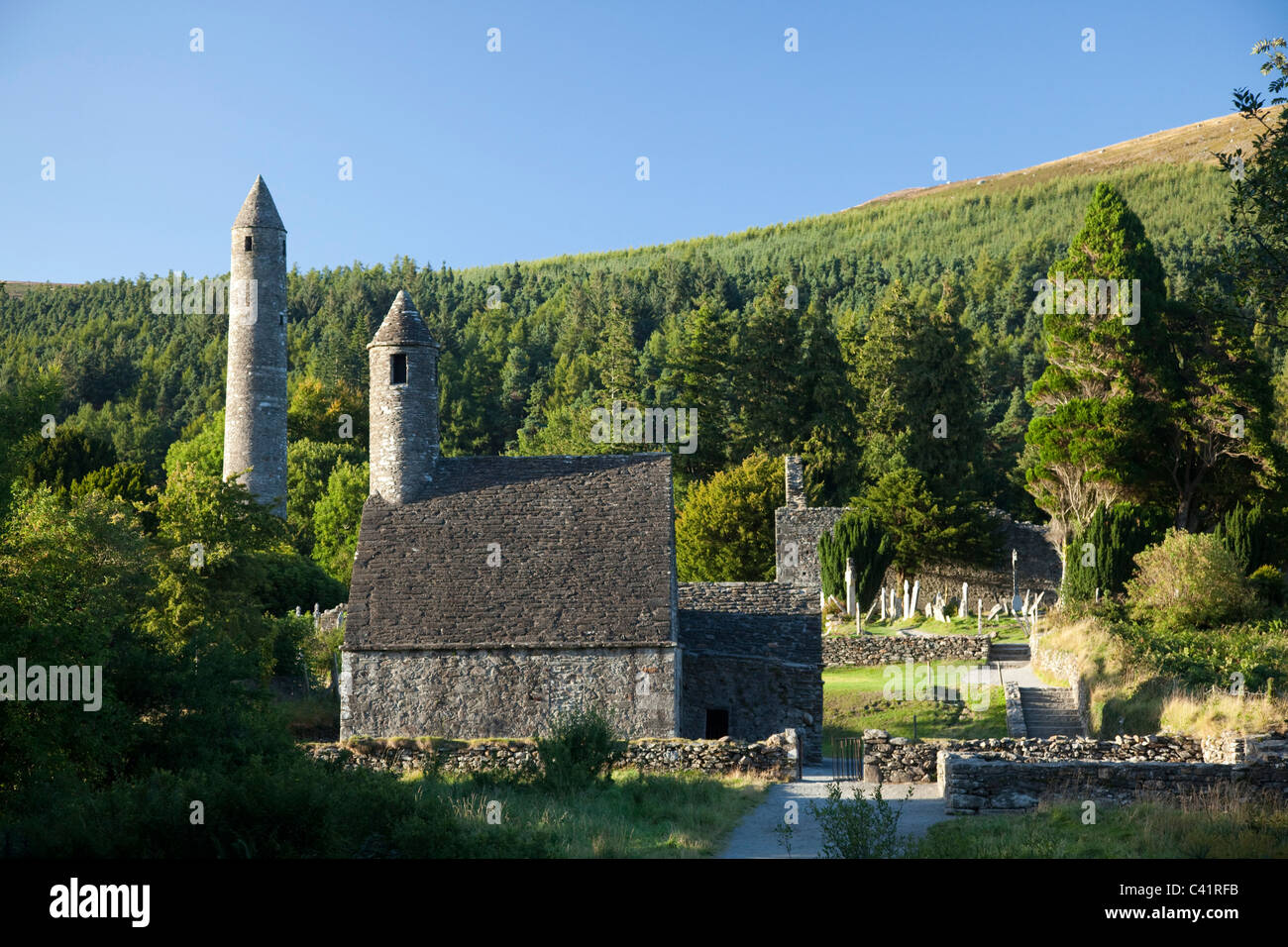 St Kevin's church and round tower, Glendalough monastic site, County Wicklow, Ireland. - Stock Image