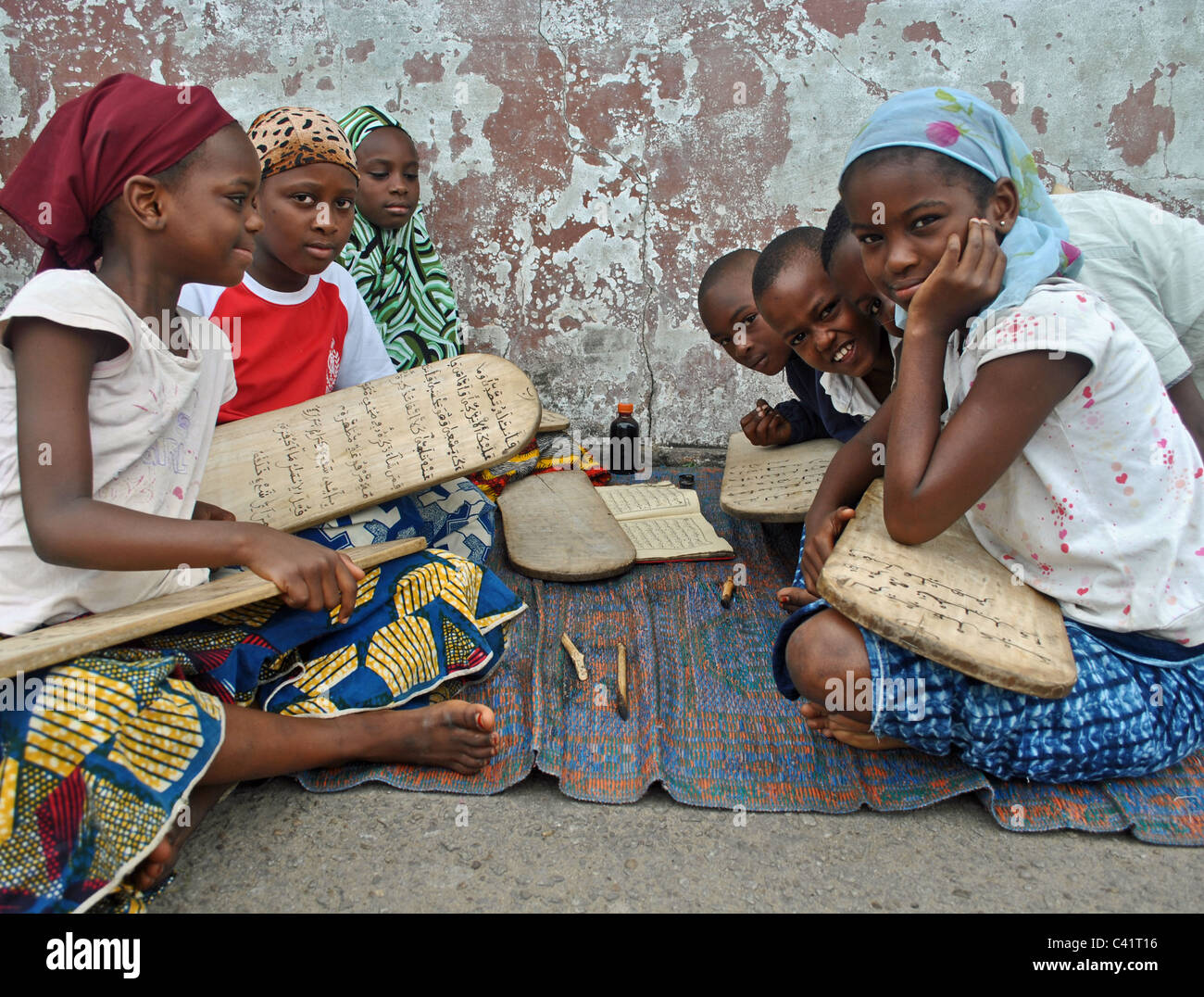 Girls learning the Quran at an islamic street school in Abidjan, Ivory coast Stock Photo