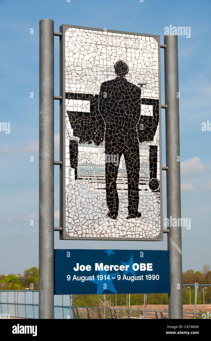 Tribute in mosaics to Joe Mercer OBE, former Manchester City manager, by Mark Kennedy. City of Manchester stadium, - Stock Image