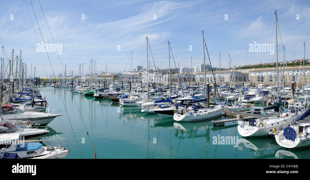 A panoramic photograph of yachts and sailing boats moored in Brighton Marina, East Sussex, England. - Stock Image