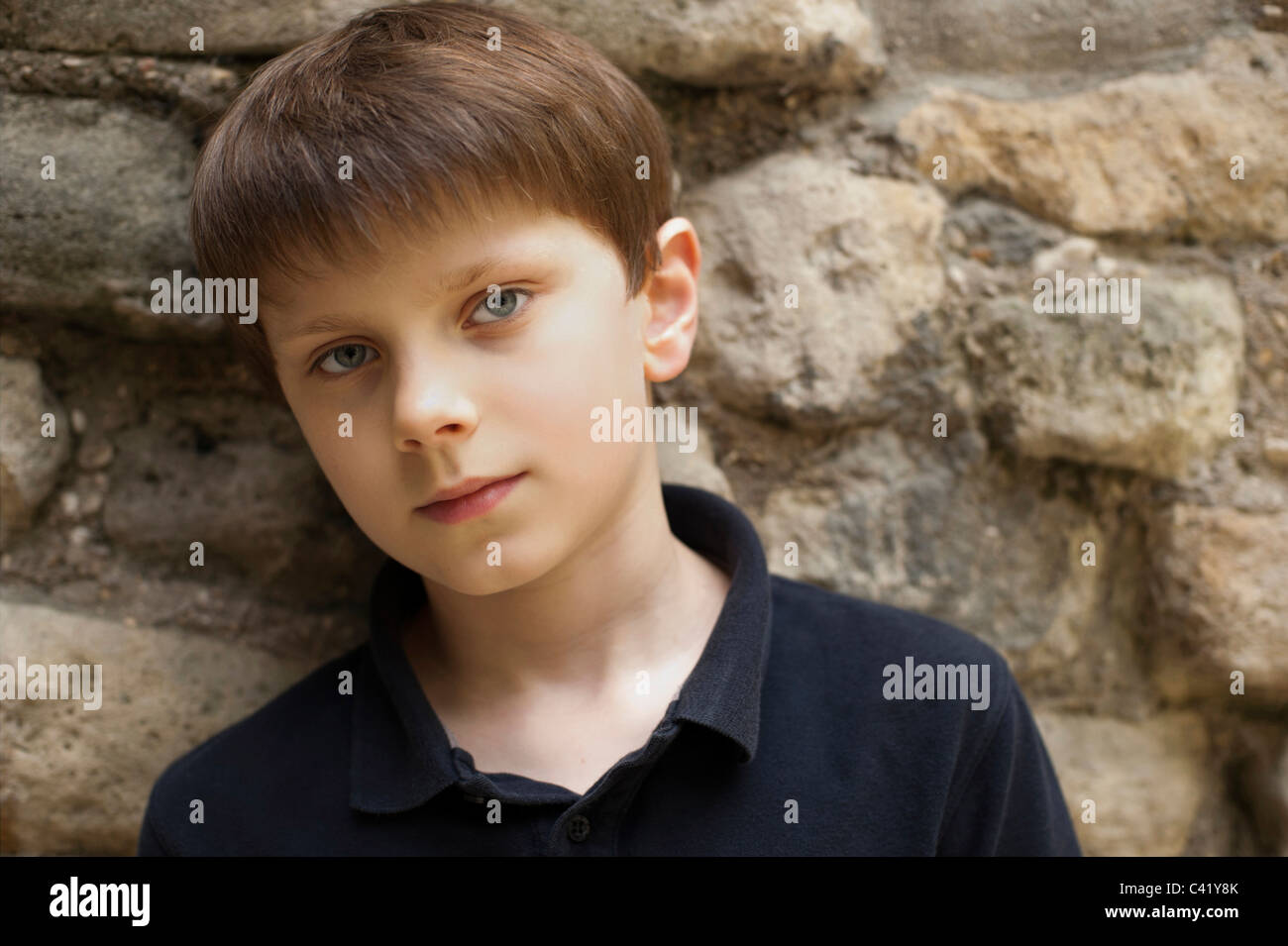 Portrait of a young boy with pale skin, blue eyes and fair hair. - Stock Image