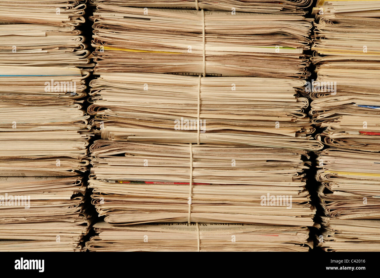Close-up of piles of newspapers to be recycled - Stock Image
