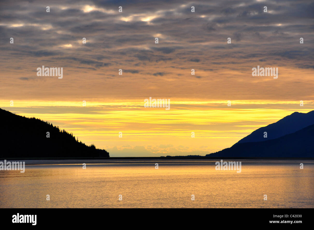 Overcast sky with Golden sunset - Stock Image