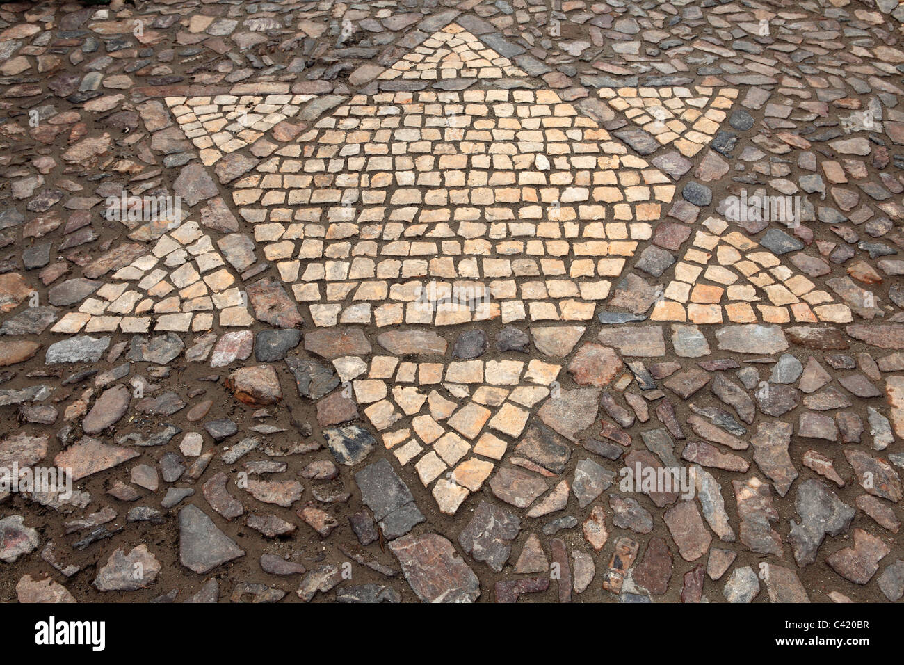 A Star of David is represented in cobbles in Caceres, Extremadura, Spain. - Stock Image