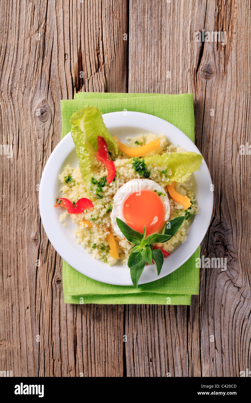 Vegetarian meal - Couscous salad and fried egg - Stock Image